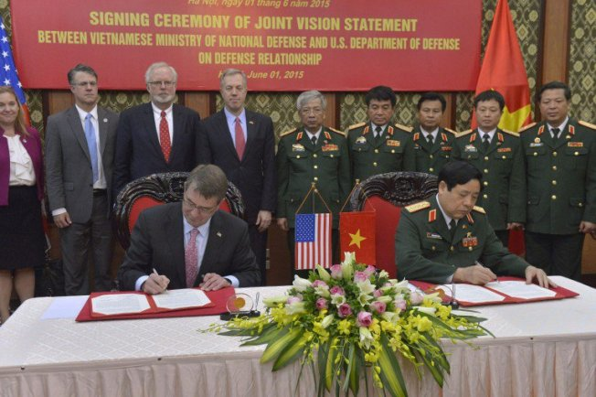 SecDef-Carter-signs-mil-to-mil-with-Vietnamese-150601-D-NI589-961-768x512