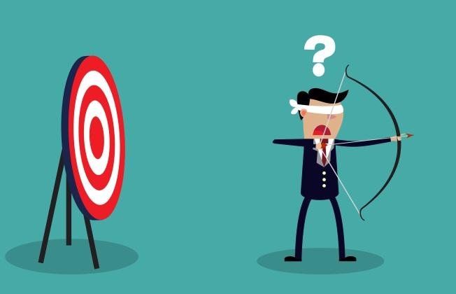 Blindfold businessman look for target
