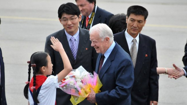 Jimmy Carter...In this photo released by China's Xinhua News Age
