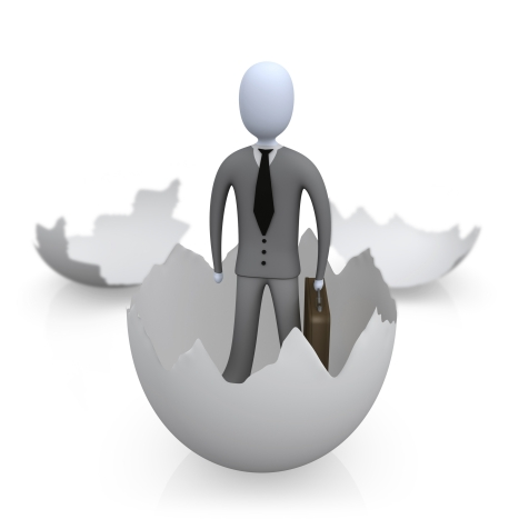 Businessman Carrying A Briefcase And Coming Out Of An Eggshell Clipart Illustration Image